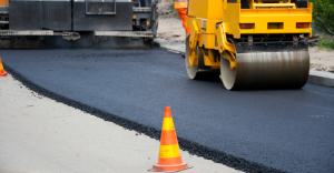 Milling and paving a roadway